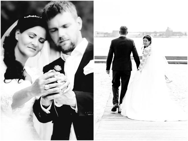 Hochzeitsfotografie, Hochzeitspaar steht verliebt zusammen und hält eine Blume in der Hand - Hochzeitsfotografie in Altefähr - Hochzeitsfotograf_Ruegen_Stralsund